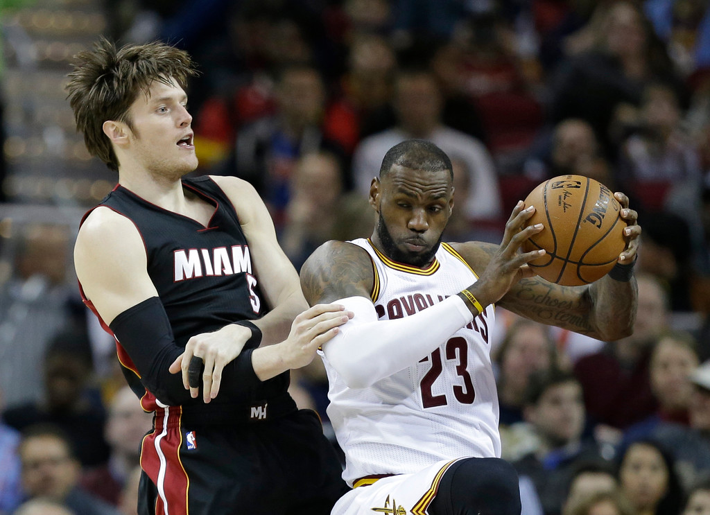 . Cleveland Cavaliers\' LeBron James (23) grabs a rebound ahead of Miami Heat\'s Luke Babbitt (5) in the first half of an NBA basketball game, Monday, March 6, 2017, in Cleveland. (AP Photo/Tony Dejak)