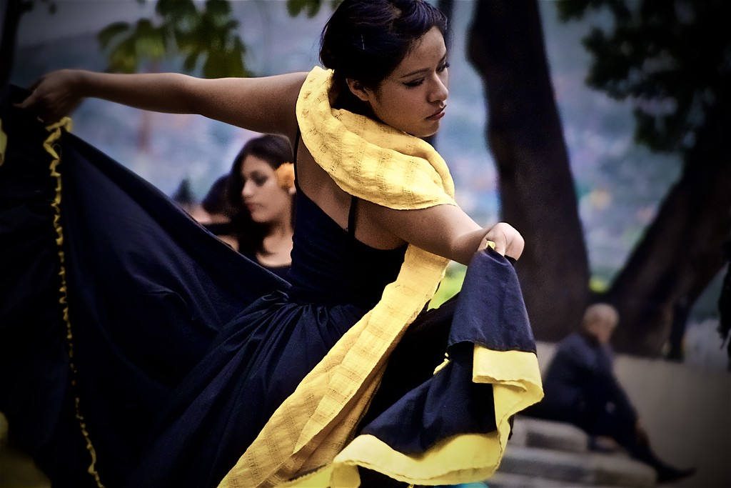 Street performers dance during Day of the Dead ceremonies in Oaxaca, Mexico.