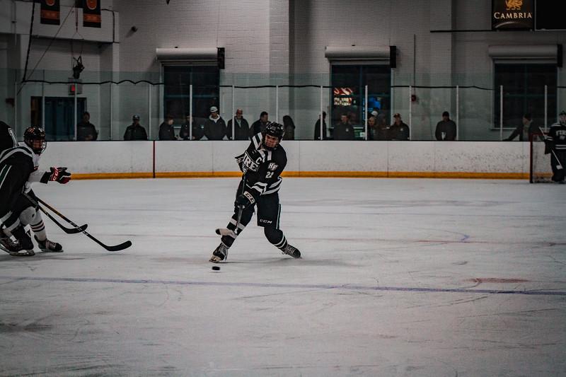 Holy Family Boys Varsity Hockey vs. Elk River, 12/27/19: Jaden Anderson '20 (22)