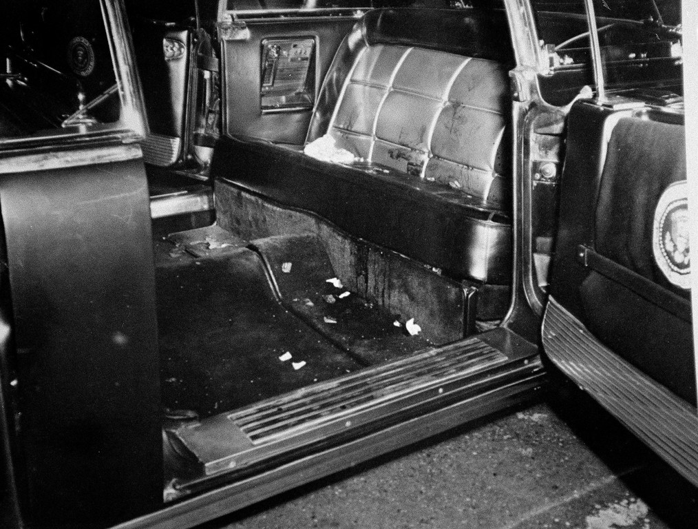 . This photo released by the National Archives shows the bloodstained interior of the limousine. It was taken after the vehicle was returned to Washington from Dallas and  was part of nearly 50,000 photos and documents released  from the assassination investigation.  Associated Press file