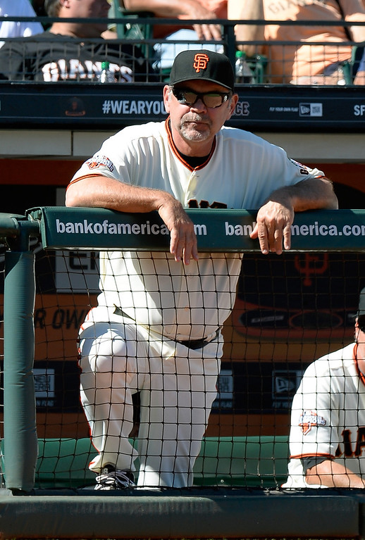 . SAN FRANCISCO, CA - APRIL 10: Manager Bruce Bochy #15 of the San Francisco Giants looks on from the dugout against the Colorado Rockies in the bottom of the seventh inning at AT&T Park on April 10, 2013 in San Francisco, California. (Photo by Thearon W. Henderson/Getty Images)