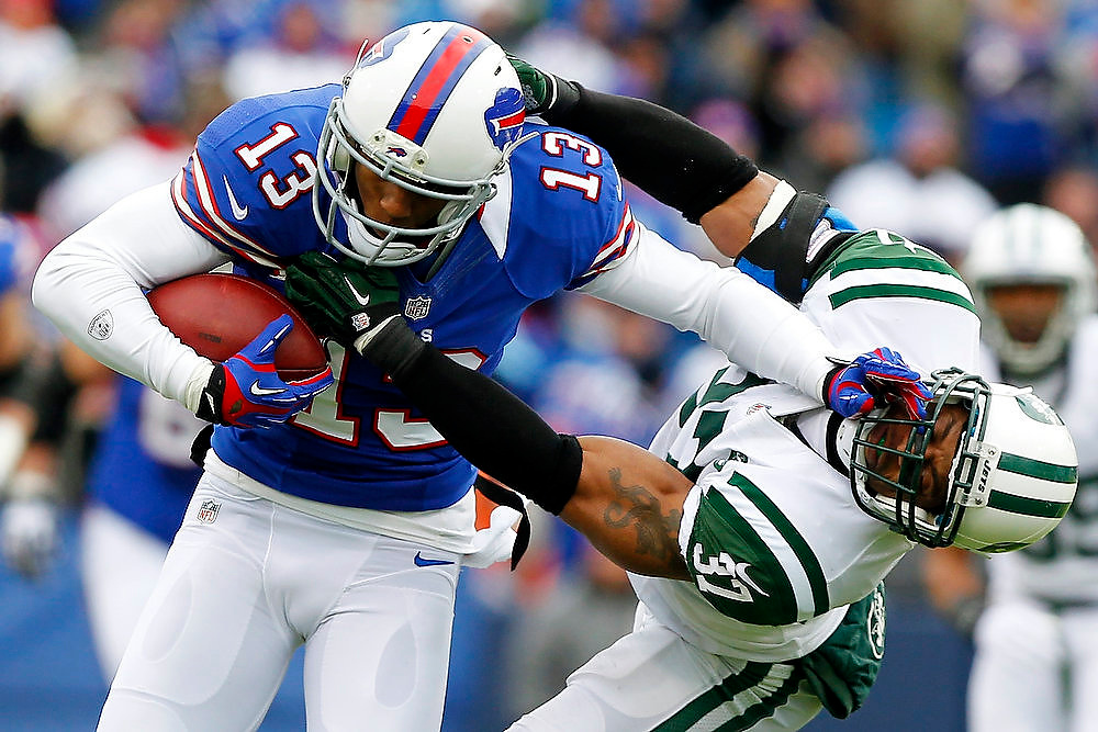 . Buffalo Bills wide receiver Stevie Johnson (13) pushes off New York Jets strong safety Yeremiah Bell (37) during the first half of an NFL football game,. Sunday, Dec. 30, 2012, in Orchard Park, N.Y. (AP Photo/Bill Wippert)