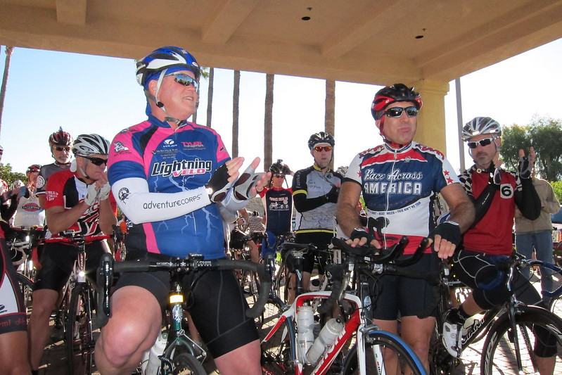 Team riders greet Michael Shermer (r of center).