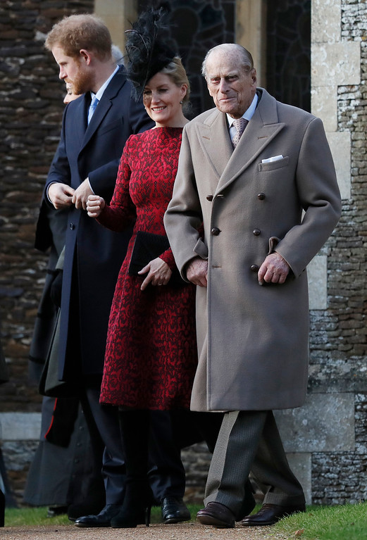 . Britain\'s Prince Philip, right, Sophie, the Countess of Wessex, and Prince Harry, left, leave after attending a Christmas day church service in Sandringham, England, Sunday, Dec. 25, 2016. A heavy cold is keeping Queen Elizabeth II from attending the traditional Christmas morning church service near her Sandringham estate. (AP Photo/Kirsty Wigglesworth)