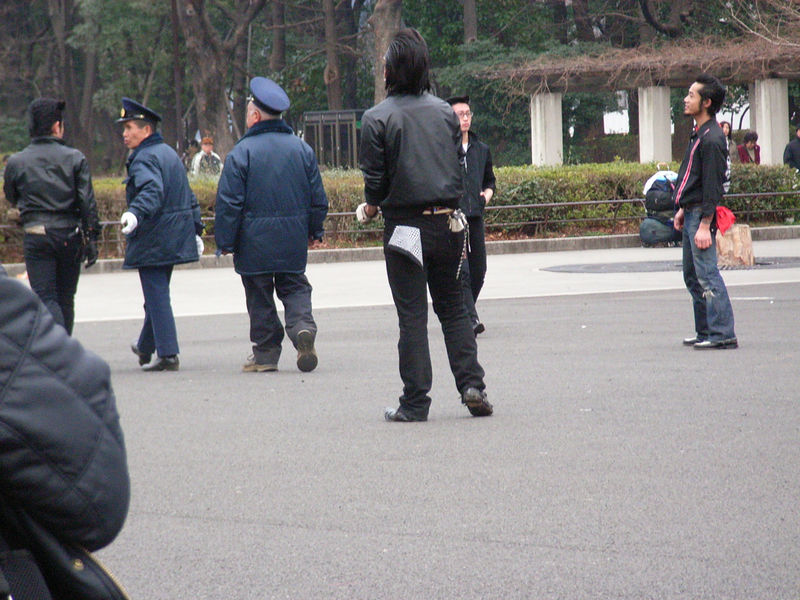 Japanese Elvis guys getting harassed by the police.