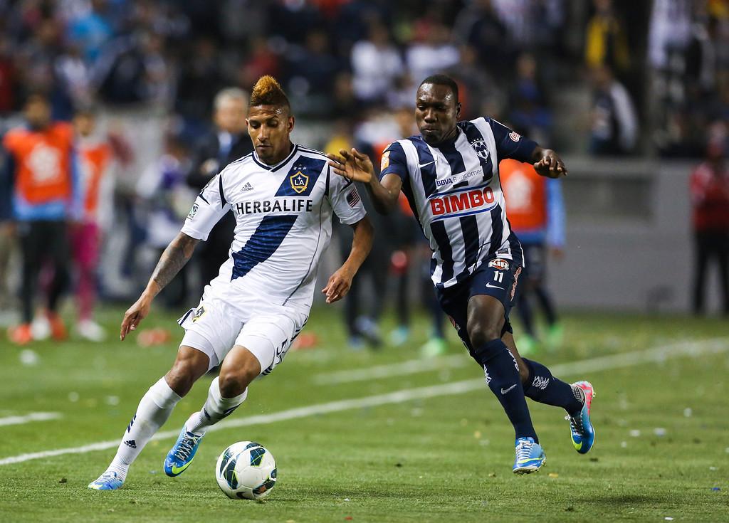 . Los Angeles Galaxy defender Sean Franklin, left, and Monterrey forward Sergio Santana during the CONCACAF Champions League semifinal, Wednesday, April 3, 2013, in Carson, Calif. Monterrey won 2-1. (AP Photo/Bret Hartman)