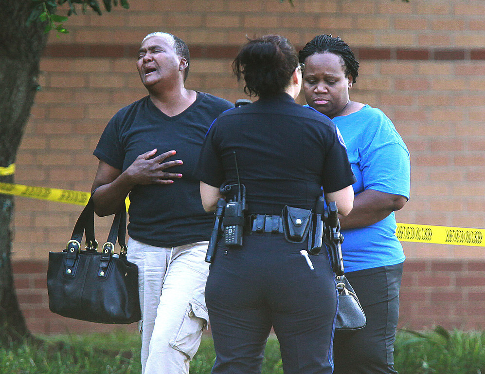 . A pair of women react after at least one person was killed and others injured in an altercation inside Spring High School Wednesday, Sept. 4, 2013, in Spring, Texas. The stabbing happened about 7 a.m. on the campus at 19428 North Freeway, according to the Harris County Sheriff\'s Office. (AP Photo/The Houston Chronicle, Mayra Beltran)