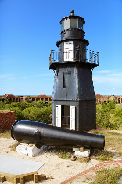 The Fort Jefferson light house with a canon in the foreground