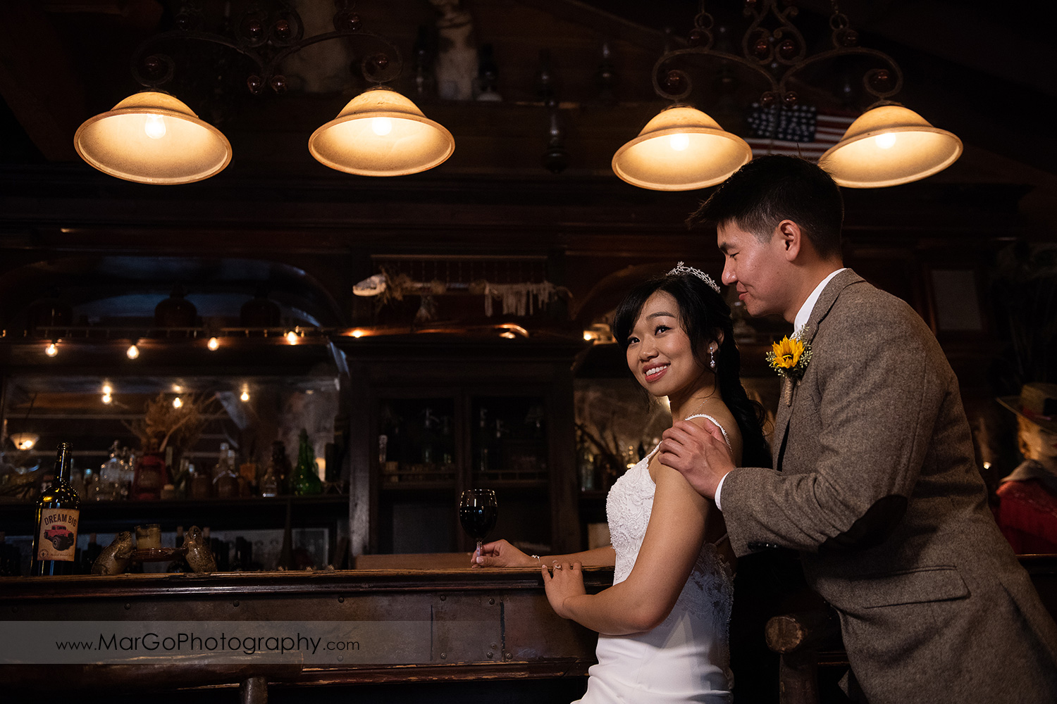 bride and groom at the bar at Long Branch Saloon & Farms in Half Moon Bay