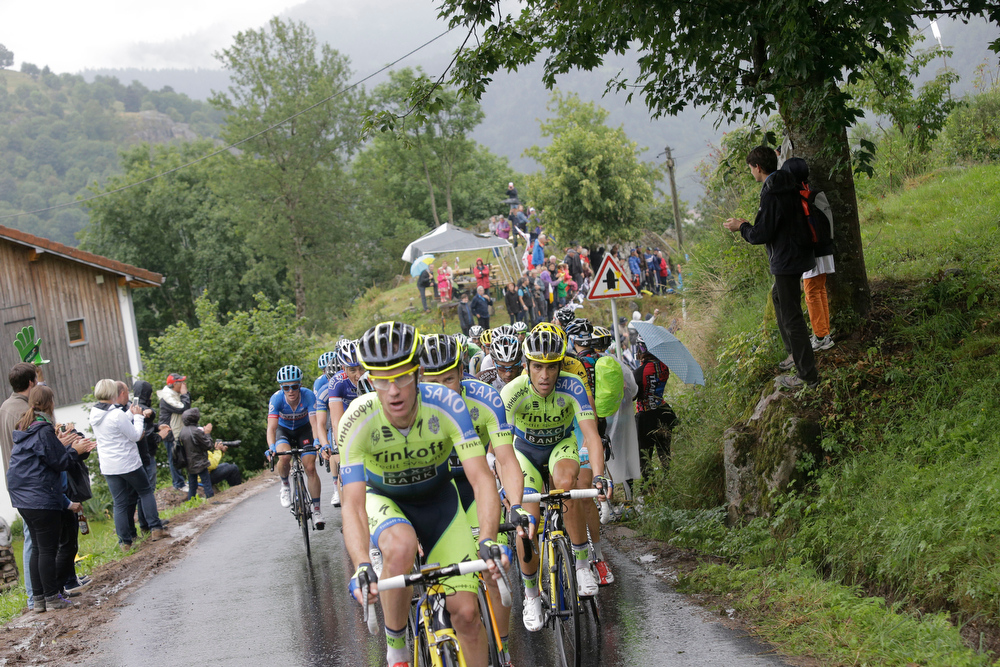 . The pack with Spain\'s Alberto Contador, in third position rides during the eighth stage of the Tour de France cycling race over 161 kilometers (100 miles) with start in Tomblaine and finish in Gerardmer, France, Saturday, July 12, 2014. (AP Photo/Laurent Cipriani)