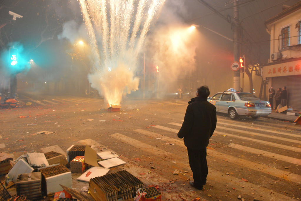 . Fireworks explode in a street of Shanghai on the eve of Chinese New Year on January 30, 2014.   AFP PHOTO/Peter PARKS/AFP/Getty Images