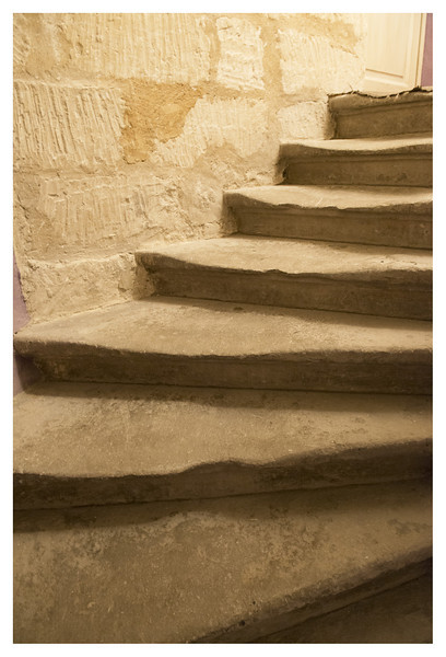Stairs to our room at the B&B in Uzes.  Look how worn they are.  This was a very old building but had been restored into a lovely place to stay.