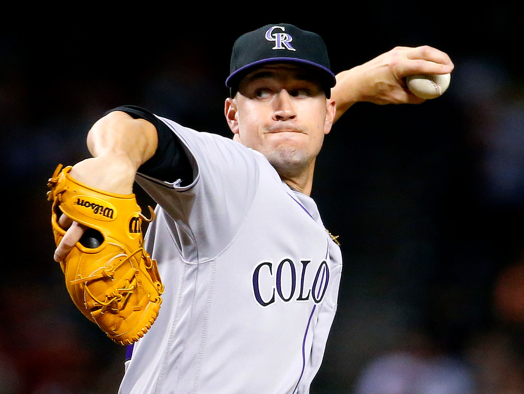 . Colorado Rockies pitcher Chris Rusin (52) throws against the Arizona Diamondbacks during the first inning of a baseball game, Saturday, April 30, 2016, in Phoenix. (AP Photo/Matt York)