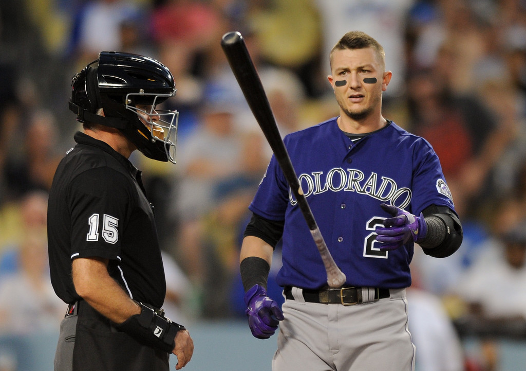 . The Rockies\' Troy Tulowitzki tosses his bat after striking out against the Dodgers, Friday, July 12, 2013, at Dodger Stadium. (Michael Owen Baker/Staff Photographer)