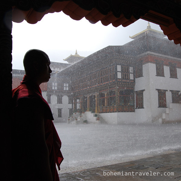 monk at Tashichho Dzong in Thimphu Bhutan during rain.jpg