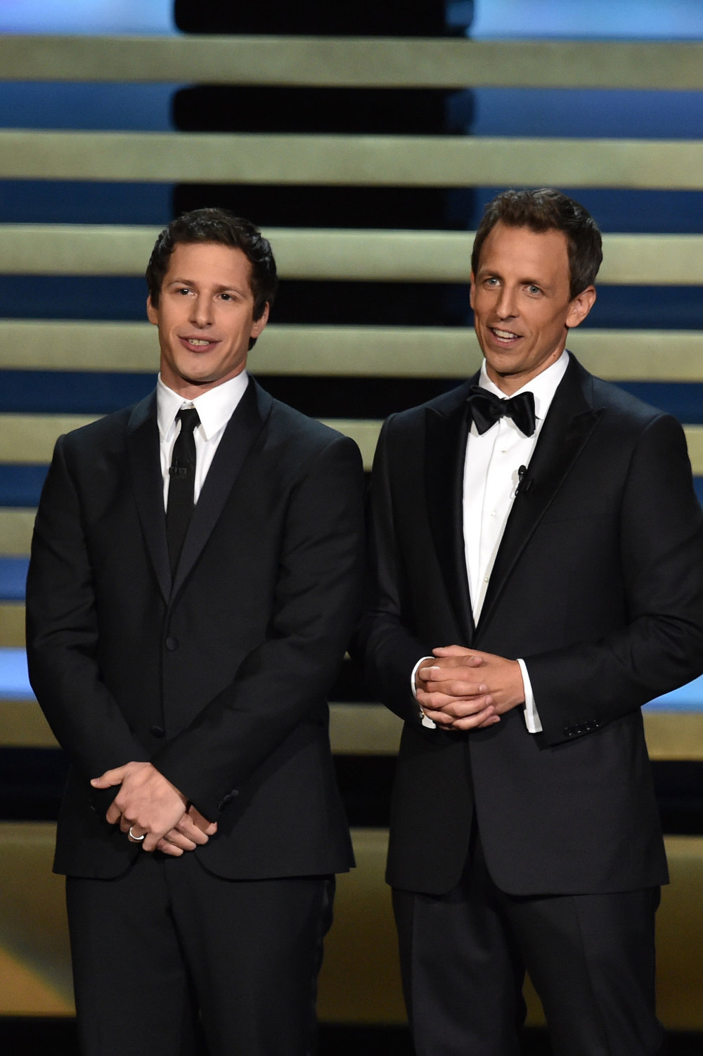 . Actor Andy Samberg (L) and host Seth Meyers speak onstage at the 66th Annual Primetime Emmy Awards held at Nokia Theatre L.A. Live on August 25, 2014 in Los Angeles, California.  (Photo by Kevin Winter/Getty Images)