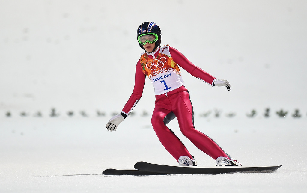 . Sarah Hendrickson of the United States lands during the Ladies\' Normal Hill Individual final round on day 4 of the Sochi 2014 Winter Olympics at the RusSki Gorki Ski Jumping Center on February 11, 2014 in Sochi, Russia.  (Photo by Lars Baron/Getty Images)