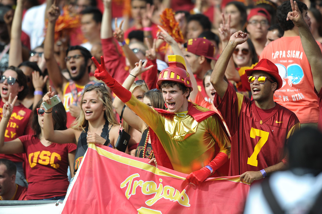 . USC students cheer during their game against Utah, Saturday, October 26, 2013, at the L.A. Memorial Coliseum. (Michael Owen Baker/L.A. Daily News)