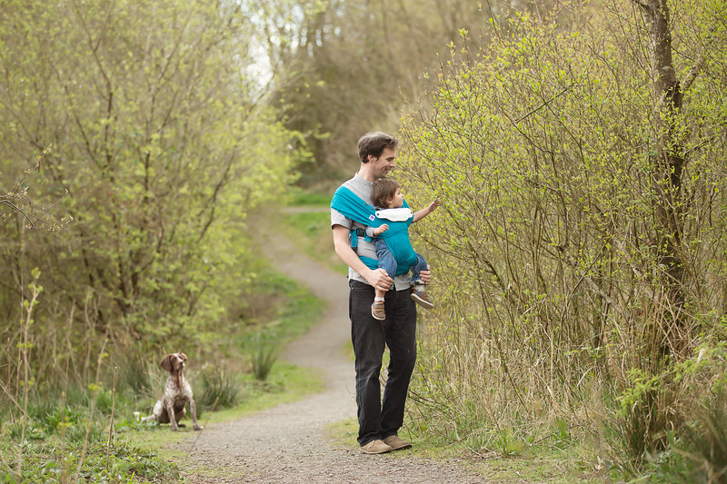 Izmi_Baby_Carrier_Cotton_Teal_Lifestyle_Front_Facing_Carry_Dad_With_Girl_Woodland.jpg