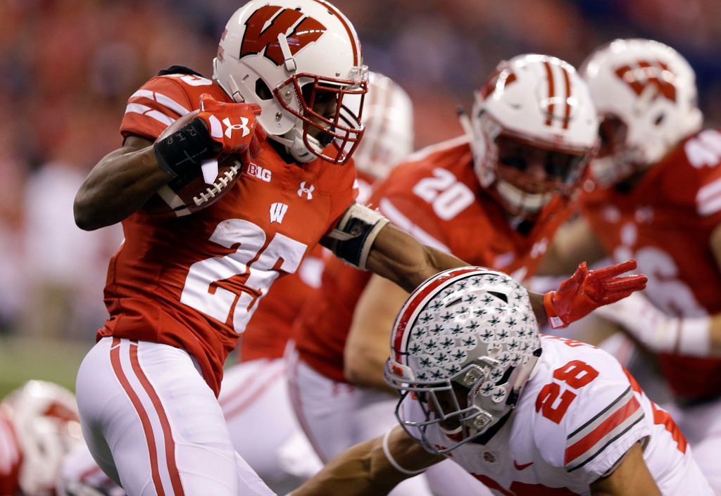 . Wisconsin cornerback Derrick Tindal as Ohio State running back Jordan Leasure defends during the first half of the Big Ten championship NCAA college football game, Saturday, Dec. 2, 2017, in Indianapolis. (AP Photo/Michael Conroy)