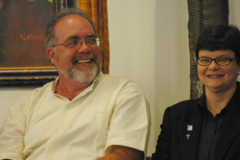 The Rev. John Dumke and Ann Holmstrom share a lighter moment.