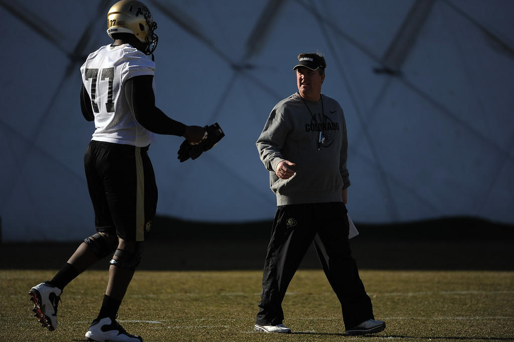 . BOULDER, CO- MARCH 7 :  Head coach Mike MacIntyre talks with offensive lineman Stephane Nembot, #77 during practice. The Colorado Buffaloes football team hit the practice field for the first time this season with new head coach Mike MacIntyre in Boulder, CO on March 7, 2013. (Photo By Helen H. Richardson/ The Denver Post)
