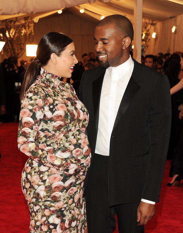 """. Kim Kardashian, left, and Kanye West attend The Metropolitan Museum of Art\'s Costume Institute benefit celebrating \""""PUNK: Chaos to Couture\"""" on Monday, May 6, 2013, in New York. (Photo by Evan Agostini/Invision/AP)"""