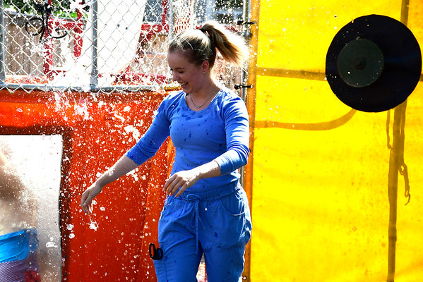 9/6/2018 Mike Orazzi | Staff Bristol Hospital's Kasey Lebel while throwing softball at the dunk tank during an employee fundraising campaign called the &quote;Operation ERgency&quote; campaign to raise funds for our Emergency Center Thursday in Bristol.