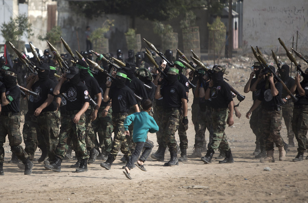 . Palestinian militants of the Ezzedine al-Qassam Brigades, Hamas\'s armed wing, stage an anti-Israel parade as part of the celebrations marking the first anniversary of an Israeli army operation in Gaza, on November 14, 2013. AFP PHOTO / MAHMUD HAMS/AFP/Getty Images