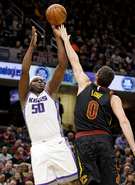 . Sacramento Kings\' Zach Randolph (50) shoots over Cleveland Cavaliers\' Channing Frye (8) in the second half of an NBA basketball game, Wednesday, Dec. 6, 2017, in Cleveland. (AP Photo/Tony Dejak)