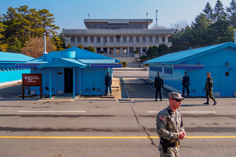 The Joint Security Area. The North Korean border lies in the middle of the blue UN buildings
