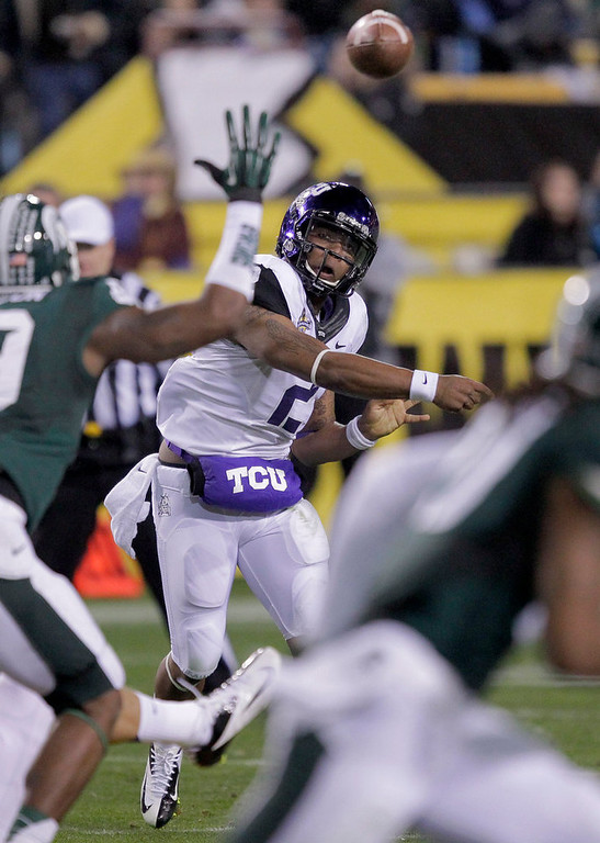 . TCU Frogs quarterback Trevone Boykin (2) throws against Michigan State during the first half of the Buffalo Wild Wings Bowl NCAA college football game, Saturday, Dec. 29, 2012, in Tempe, Ariz. (AP Photo/Matt York)