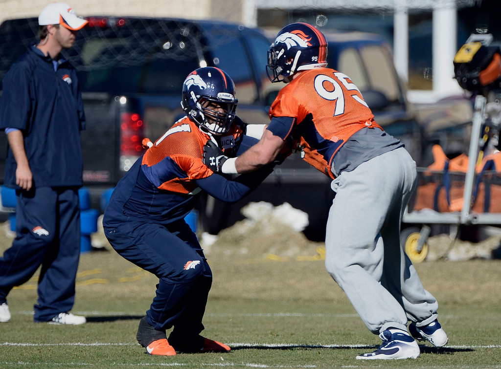 . Denver Broncos defensive end Robert Ayers (91) and Denver Broncos defensive end Derek Wolfe (95) work on drills during practice November 27, 2013 at Dove Valley (Photo by John Leyba/The Denver Post)