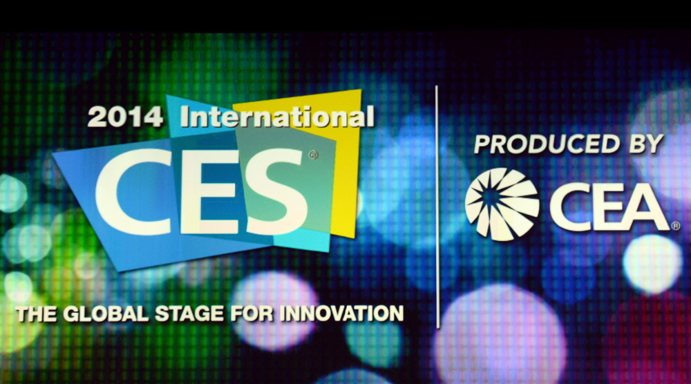 Description of . Logos for the 2014 International CES and the Consumer Electronics Association are seen on a screen before a keynote address by Intel Corp. CEO Brian Krzanich at the 2014 International CES at The Venetian Las Vegas on January 6, 2014 in Las Vegas, Nevada. CES, the world's largest annual consumer technology trade show, runs from January 7-10 and is expected to feature 3,200 exhibitors showing off their latest products and services to about 150,000 attendees.  (Photo by Ethan Miller/Getty Images)