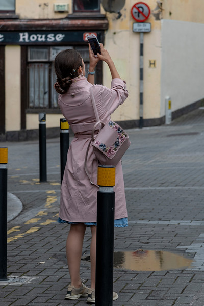 View of women taking selfie on the street, Shandon, City of Cork, County Cork, Ireland