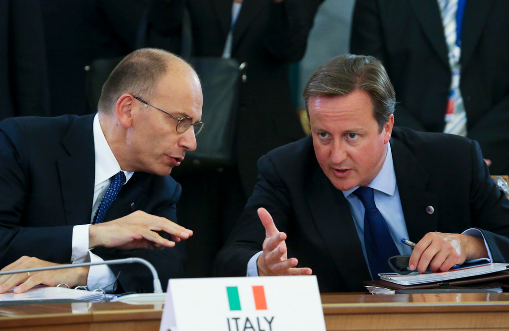 . Italian Prime Minister Enrico Letta, left, speaks with British Prime Minister David Cameron during a round table meeting at the G-20 summit in St. Petersburg, Russia on Thursday, Sept. 5, 2013. (AP Photo/Sergei Karpukhin, Pool)