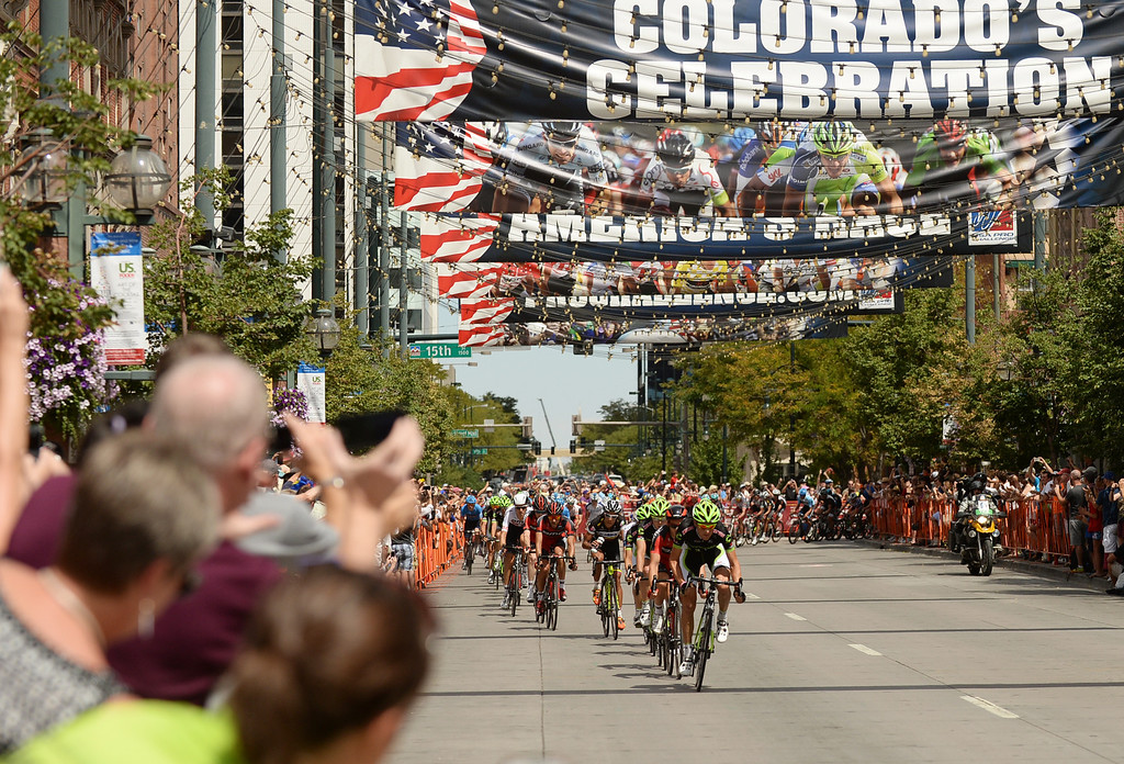. Cyclists pass by Larimer Square during the 75-mile, 7th stage of the 2013 USA Pro Challenge race in Denver on August 25, 2013. (Photo by Hyoung Chang/The Denver Post)