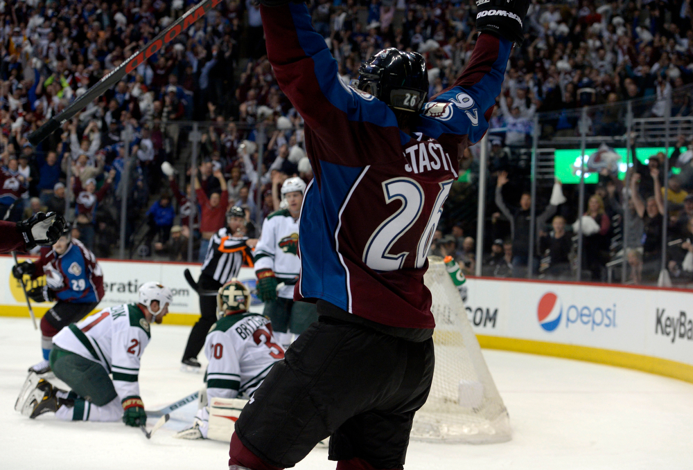 . Paul Stastny (26) of the Colorado Avalanche celebrates after he gets the puck past Ilya Bryzgalov (30) of the Minnesota Wild with 13 seconds left in the third period of action. Stastny was assisted by Erik Johnson (6) and Nathan MacKinnon (29) of the Colorado Avalanche.  The Colorado Avalanche hosted the Minnesota Wild for the first playoff game at the Pepsi Center on Thursday, April 17, 2014. (Photo by John Leyba/The Denver Post)