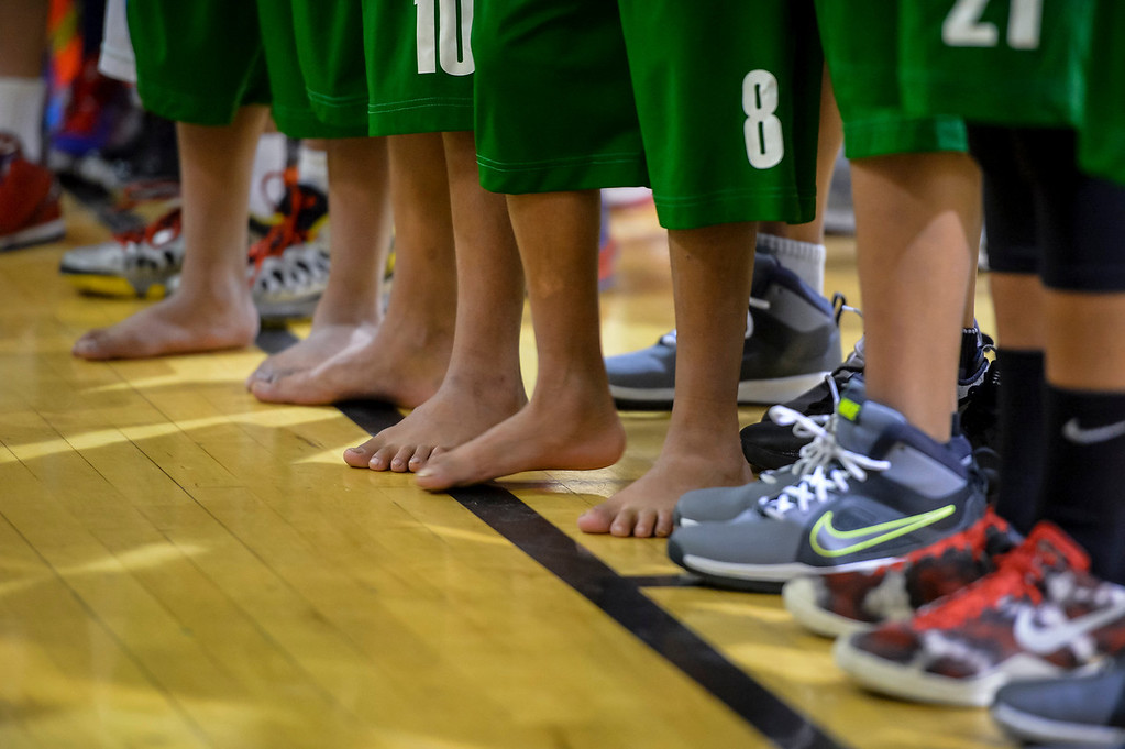 ". Triqui kids basketball team, from the mountainous region of Oaxaca, Mexico, who have been called the ""Barefoot Champions of the Mountain,\"" are known throughout their native Mexico for playing basketball without shoes took on the local Top Flight boys team at the Pacific Boys Lodge in Woodland Hills, CA Wednesday, December 18, 2013.  The Triqui team waits to take the floor for the start of the game.  (Photo by David Crane/Los Angeles Daily News)"