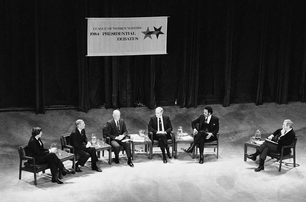 . Candidate for the Democratic nomination for President take part in a debate sponsored by the League of Women Voters, Sunday, March 12, 1984, Atlanta, Ga. From left are: Gary Hart, Walter Mondale, John Glenn, George McGovern and Jesse Jackson. (AP Photo/Curtis Compton)