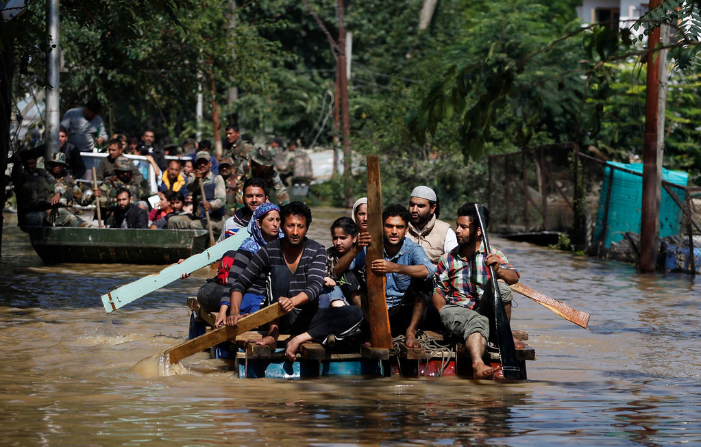 . Kashmiri residents use makeshift rafts to rescue flood affected people in Srinagar, in Indian-controlled Kashmir, Wednesday, Sept.10, 2014.   (AP Photo/Altaf Qadri)