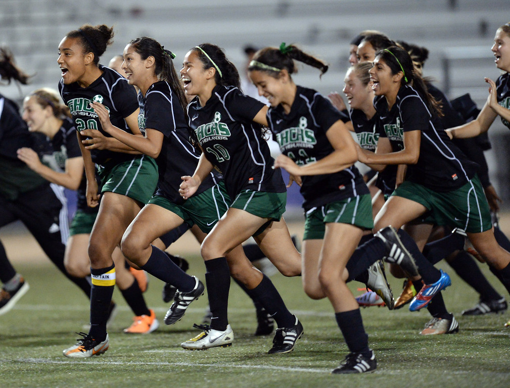 . Granada players run to goalie Andreya Ventura after winning in a shoot-out during their City Section Division I soccer final game against Palisades at Contreras Learning Complex in Los Angeles Saturday, March 8, 2014. (Photo by Hans Gutknecht/Los Angeles Daily News)