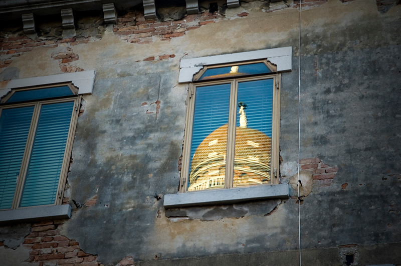 The top of Madonna dell'Orto bell tower reflected on a window, Venice, Italy