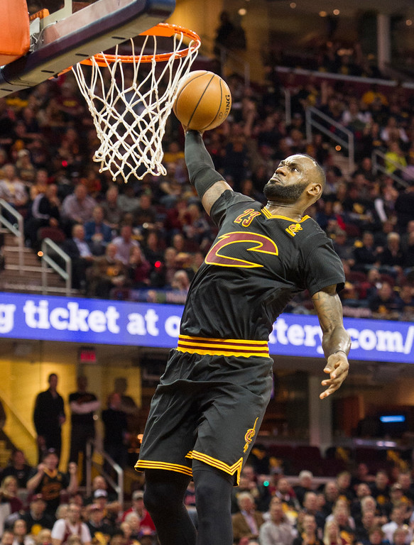 . Cleveland Cavaliers\' LeBron James dunks against the New York Knicks during the first half of an NBA basketball game in Cleveland, Tuesday, Oct. 25, 2016. (AP Photo/Phil Long)