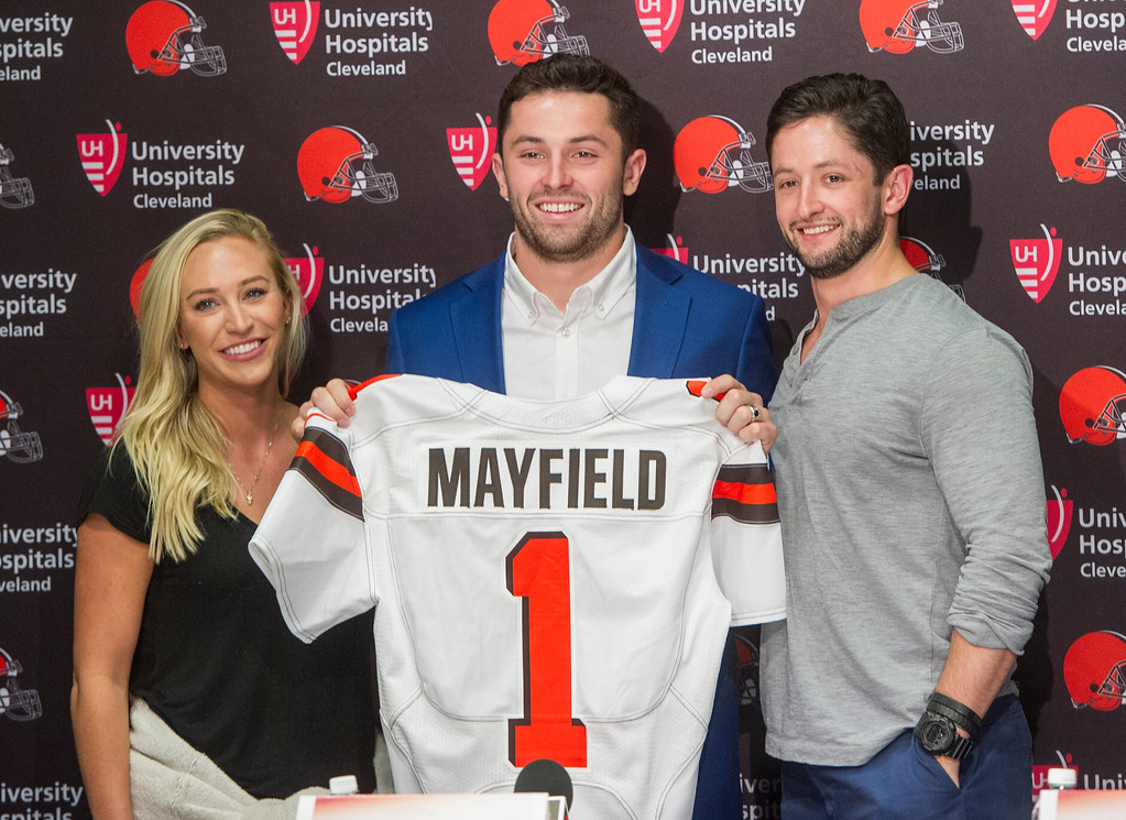 . Cleveland Browns first-round draft  pick Baker Mayfield, center, stands with his girlfriend, Emily Wilkinson, and brother Matt Mayfield after a news conference at the NFL football team\'s headquarters in Berea, Ohio, Friday, April 27, 2018. Mayfield was the first selection of the draft. (AP Photo/Phil Long)