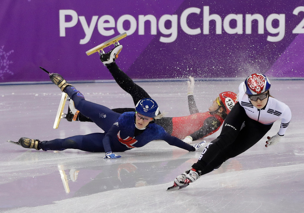 . Choi Min-jeong of South Korea races ahead of Elise Christie, left, of Britain and Li Jinyu of China as they crash out of their women\'s 1500 meters short track speedskating semifinal in the Gangneung Ice Arena at the 2018 Winter Olympics in Gangneung, South Korea, Saturday, Feb. 17, 2018. (AP Photo/David J. Phillip)