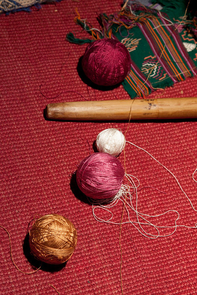 The weaver's supplies at her side