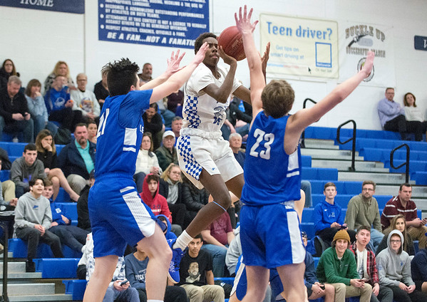 02/11/20 Wesley Bunnell | StaffrrPlainville boys basketball at home on Tuesday night against Lewis Mills. Omarion Miller (23).