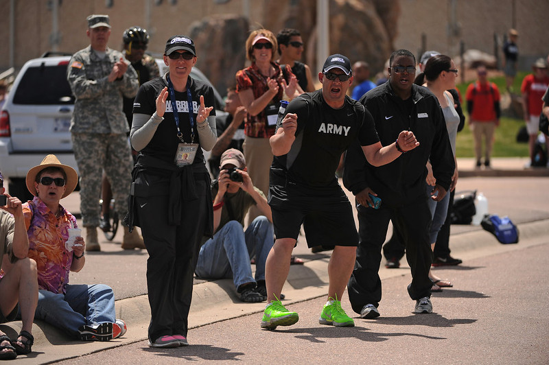 . Fans lined the course to cheer on their athletes.  The fourth annual Warrior Games cycling event took started and finished at Falcon Stadium on the grounds of the Air Force Academy in Colorado Springs, CO on May 12, 2013.  HRH Prince Harry was on hand to start the race as well as to hand out medals at the finish line.   A total of 260 wounded, ill and injured service members and veterans came to compete in the week long games.  Members of the Army, Marine Corps, Navy/Coast Guard/Air Force. Special Operations and the British Armed Forces all took part in the competition.  Other events included in the Warrior Games are shooting, sitting volleyball, track & field and wheelchair basketball.  (Photo by Helen H. Richardson/The Denver Post)