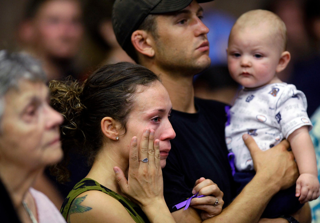 . A woman wipes away tears during a memorial service for the 19 firefighters   . REUTERS/Joshua Lott
